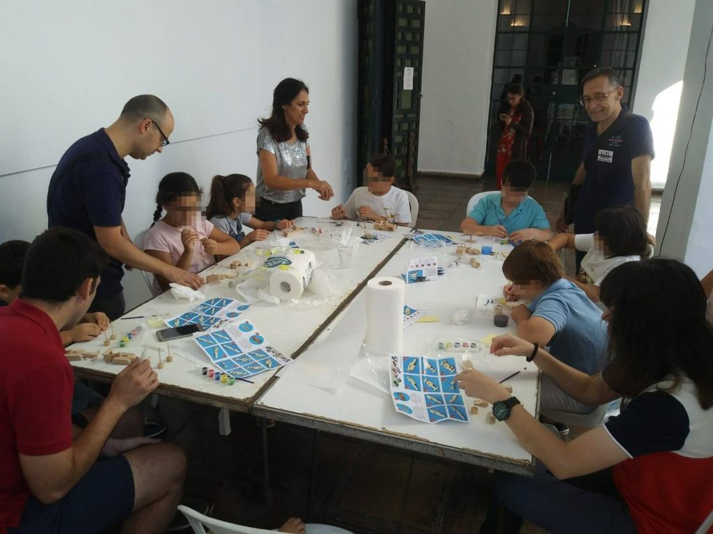 Children are also learning how to assemble a wooden model ship with junior kits.
