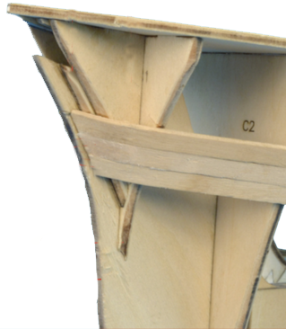 Placement of Bow and Stern Parts on the Wooden Ship Model Assembly.